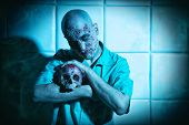 A portrait of a sick scientist after a failed experiment in the blue light holding a skull. desperat poster