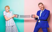 Man And Woman Stretching Expander Opposite Sides. Business Competition Between Businessman And Femal poster