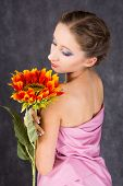 foto of toga  - female dressed pink toga with orange sunflower - JPG