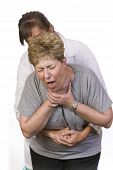 picture of choke  - Using the Heimlich Maneuver on a choking person