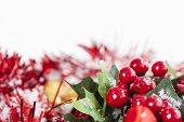 image of winterberry  - Christmas border with red Holly berries and ribbon covered by snow with copy space - JPG