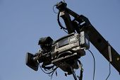 picture of high-def  - TV camera on the crane and with blue sky in the background - JPG
