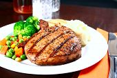 stock photo of pork chop  - image of delicious of tender pork chop meal