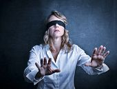 pic of blindfolded man  - beautiful woman walking blindfolded with hands forward - JPG