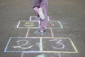 picture of hopscotch  - Low section of girl playing hop - JPG