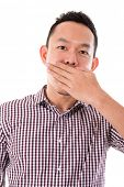Asian businessman get shock, hands covering mouth and isolated on white background