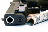 picture of 9mm  - Close up of 9mm gun and dollars  - JPG