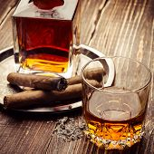 Vintage cognac with cigar