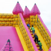 picture of inflatable slide  - Children climb steps in infatable bumper castle - JPG