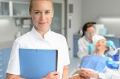 stock photo of dental  - Dental assistant dentist checkup woman patient at stomatology clinic - JPG