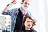 image of hairspray  - Male coiffeur giving women hairstyling with hairspray in shop - JPG
