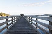 foto of orca  - Horizontal photo of Orcas Island harbor wooden walkway within the San Juan Islands during summer evening - JPG