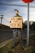 Young Businessman Holding 401K Sign