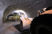 picture of mines  - Big loader and big machinery in a dark mine - JPG