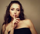 pic of shh  - Sexual makeup woman showing silent sign with finger near lips - JPG
