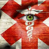 stock photo of sceptre  - Caduceus painted on a mans face to show support to medical heroes and first aiders - JPG