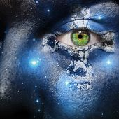 stock photo of celtic  - Face overlay of the seven sisters constellation with a Celtic cross centering around the green eye - JPG