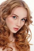 stock photo of perm  - Portrait of young beautiful woman with long red curly hair and fresh make - JPG