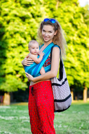 stock photo of sling bag  - Young mother and baby in a sling - JPG
