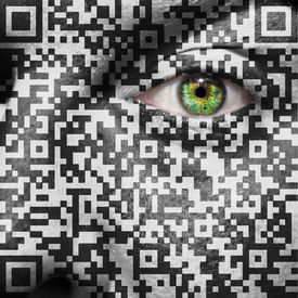 pic of slavery  - qr code superimposed on a mans face to suggest the concept of slavery or human trafficking - JPG
