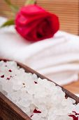 foto of swedish sauna  - aromatic rose bathing salt with rose on white towel - JPG
