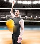 picture of volleyball  - Volleyball player on gray uniform on volleyball court - JPG