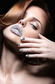 stock photo of long nails  - Beautiful girl with bright nails and lips of crystals - JPG