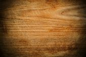 picture of woodgrain  - Wood panel or veneer background texture with decorative woodgrain and vignetting - JPG