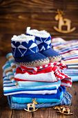 picture of booty  - Baby clothes with ugg booties on a wooden table - JPG