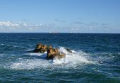image of barge  - the view with the rocks in atlantic ocean and two barges on the background Portugal - JPG