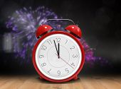 pic of count down  - Alarm clock counting down to twelve against wooden planks - JPG