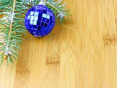foto of blue spruce  - blue christmas decoration of the branches of spruce on brown background - JPG