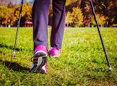 pic of pole  - Vintage retro effect filtered hipster style image of nordic walking adventure and exercising concept  - JPG