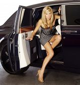 Woman exiting a luxury car