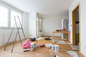 stock photo of tool  - Home renovation in room full of painting tools