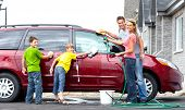 stock photo of car wash  - Smiling happy family washing the family car - JPG