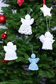 picture of christmas angel  - Knitted Christmas angels on Christmas tree - JPG