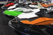 stock photo of jet-ski  - line of jet skis out on display - JPG