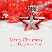 stock photo of merry christmas text  - Red Christmas decoration on defocused lights background - JPG
