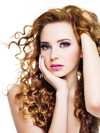 pic of beautiful woman face  - Young beautiful woman with long curly hairs  - JPG