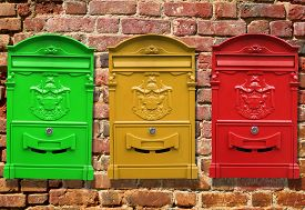 image of mailbox  - Red mailbox for letters weighs on the wall - JPG