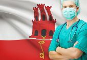 stock photo of gibraltar  - Surgeon with national flag on background  - JPG