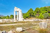 picture of epidavros  - The foundations of the Temple of Asclepius with couple of restored columns Epidavros Greece - JPG
