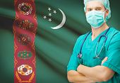 stock photo of turkmenistan  - Surgeon with national flag on background  - JPG