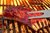 pic of bbq party  - Grilled BBQ Tasty Spicy Smoked Marinated Pork Ribs At Summer Party - JPG