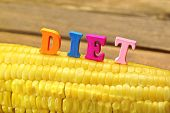 image of corn cob close-up  - Wooden Sign Diet On Fresh Sweet Corn Close - JPG