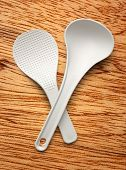 stock photo of ladle  - White spatula and ladle on the wooden background - JPG