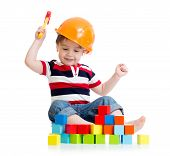 image of hard-on  - smiling child boy with hard hat and toy hammer - JPG
