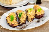foto of crust  - Meat and Tomato Stuffed Eggplant Halves with Cheese Crust selective focus on the middle eggplant crust - JPG