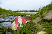 stock photo of sewage  - Sewage Water flowing into the river outdoors - JPG